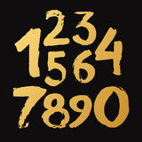 Golden Handmade drawn Numbers 0-9 written with a brush Stock Images