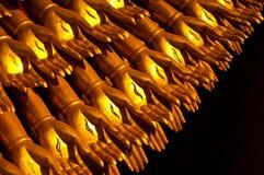 Golden hands statue. Ten thousand golden hands statue ,black background Royalty Free Stock Photo