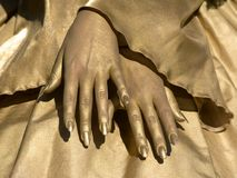 Golden hands of women Stock Photos
