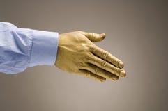 Golden Handshake. Golden hand offering handshake Royalty Free Stock Photos