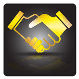Golden handshake on black background. Golden handshake with shadow and reflection. Black background. Vector image Stock Photos