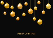 Golden  hanging Christmas balls isolated on black  background. Royalty Free Stock Photography