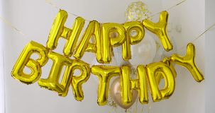Golden HAPPY BIRTHDAY words made of balloons stock footage