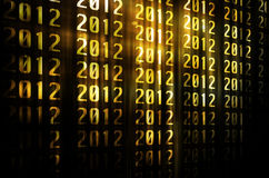 Golden happy new year 2012 with gold background Royalty Free Stock Image