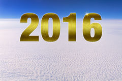 Golden Happy New Year Number 2016 Above Clouds. Golden textured number 2016 hovering in space high above a dense cloud front. Blue sky. Plenty of copy space Stock Photos