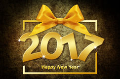 2017 golden happy New year text  on brown grunge backgro. Und Stock Image