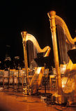 Golden Harps. Harps on a stage at a concert hall Stock Photo