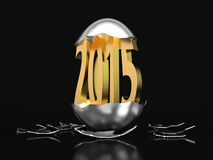 Golden 2015 hatches out of an egg. Happy new year a golden 2015 hatches out of an egg on black background Royalty Free Stock Photo