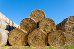 Golden Hay Pyramid. A pyramid of 6 hay bails, lit by high autumn sun Royalty Free Stock Photography