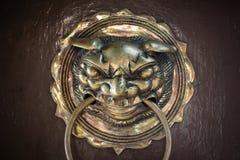 Head door knocker. Golden head door knocker closeup Royalty Free Stock Photo