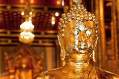 Golden head of meditating Buddha inside the historical Thai temple Stock Photo