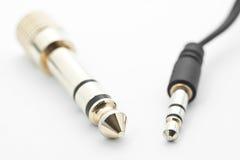 Golden headphone jack plug. Jack and mini-jack plug on white background Stock Photos