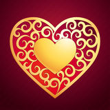Golden heart. Vector golden heart with decorative elements on dark background Stock Photography