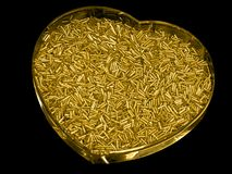 Golden heart. Like box with glass beads Stock Photography