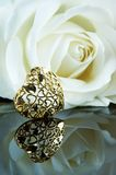 Golden heart. Valentine rose and golden heart reflected in a mirror Royalty Free Stock Image
