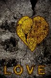 Golden heart. With LOVE on grunge background Royalty Free Stock Image