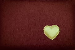 Golden heart alone on red vintage background Stock Photography