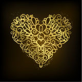 Golden heart on black background Royalty Free Stock Images
