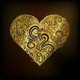 Golden heart on black background Stock Photos