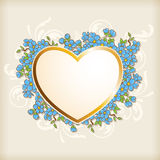 Golden heart and blue flowers Royalty Free Stock Photo