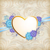 Golden heart and blue flowers Stock Images
