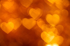 Golden heart bokeh background photo, abstract holiday backdrop Stock Photos