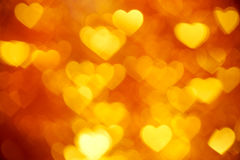 Golden heart bokeh background photo, abstract holiday backdrop Stock Images