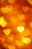 Golden heart bokeh background photo, abstract holiday backdrop Stock Photography