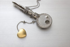 Golden heart. Chain necklace  with key Stock Photo