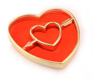 Golden heart cupido arrow Stock Photo