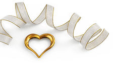 Golden heart decorated with a ribbon. A beautiful golden heart on white, decorated with an off white ribbon. Good for a valentine card Stock Image