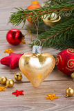 Golden heart on fir tree Stock Image