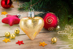 Golden heart on fir tree Royalty Free Stock Photos