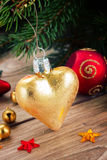 Golden heart on fir tree Royalty Free Stock Photo