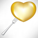Golden heart in fork Stock Photos