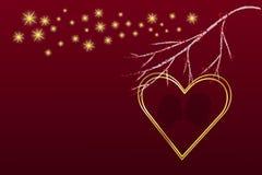 Golden heart frame below the branch Stock Images