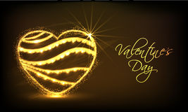Golden heart for Happy Valentines Day celebration. Royalty Free Stock Photo