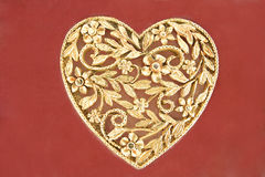 Golden heart jewelry Royalty Free Stock Image