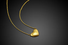 Golden heart. With necklace chain Stock Images