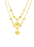 Golden heart with necklace chain. Isolated on white background Royalty Free Stock Photo