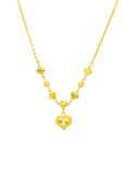 Golden heart with necklace chain Royalty Free Stock Photo