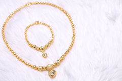 Golden heart pendant , Neck lace, Golden bracelet Royalty Free Stock Photography