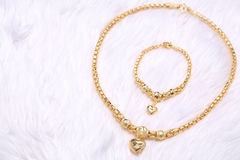 Golden heart pendant , Neck lace, Golden bracelet Stock Photos