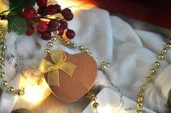 Golden Heart Present Box on Christmas Decoration with Copy Sapce Stock Photo