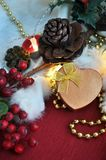Golden Heart Present Box on Christmas Decoration Stock Images