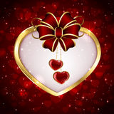 Golden heart on red background Stock Image