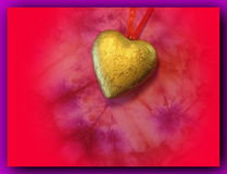 Golden heart with red ribbon Stock Photos