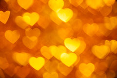 Golden heart shape holiday background Stock Images