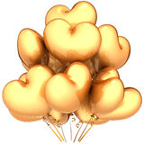 Golden heart shaped balloons Royalty Free Stock Images