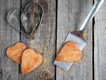 Golden Heart shaped cookies with a sugar crust on wooden table Royalty Free Stock Photography